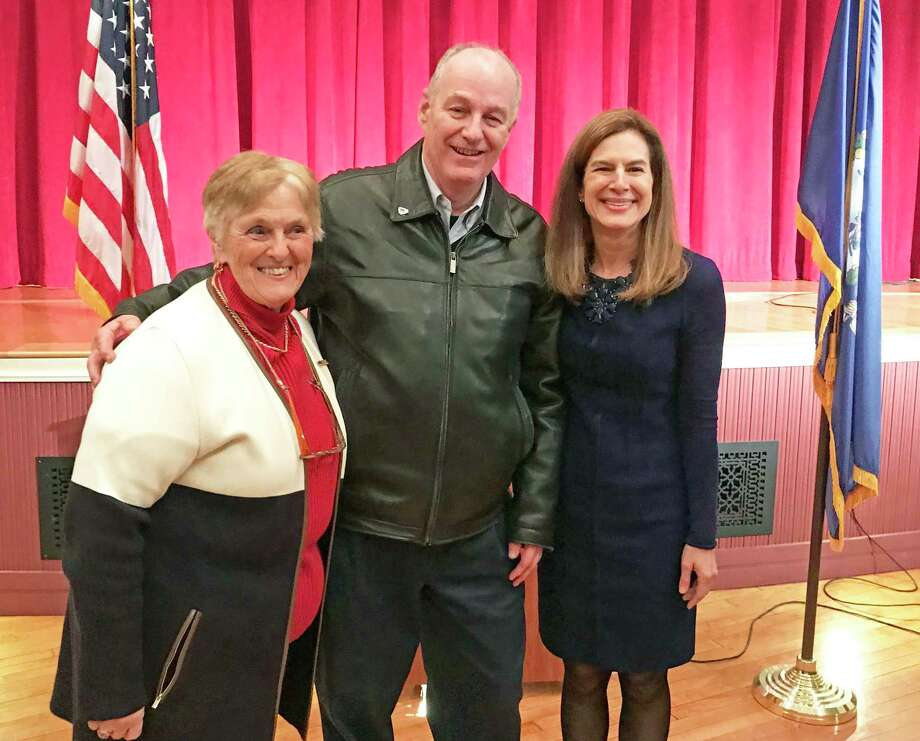 Lt. Gov. Susan Bysiewicz, right, and Deep River First Selectman Angus McDonald Jr., center, gave official state citations to 30 Vietnam War-era veterans earlier this week, including a local couple who met while they were in the service. Photo: Contributed Photo