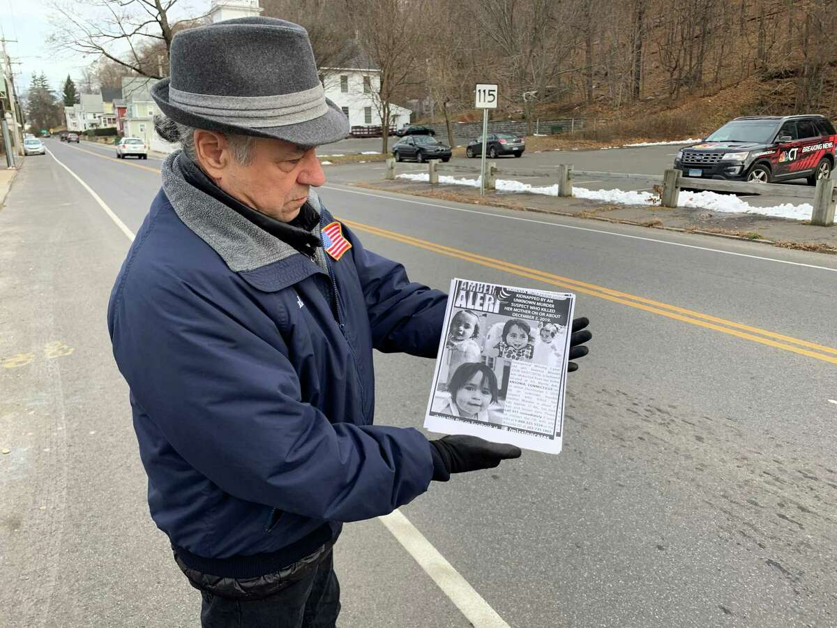 Ansonia Third Ward Alderman Joe Cassetti, a 70-year old grandfather of three, shows the flyers they are handing out flyers to passing motorists on Derby Avenue in Derby on Friday, Dec. 6, 2019. More than 300 have been given out here and on Beaver Street in Ansonia. The flyers urged residents to be on the lookout for missing Vanessa Morales.
