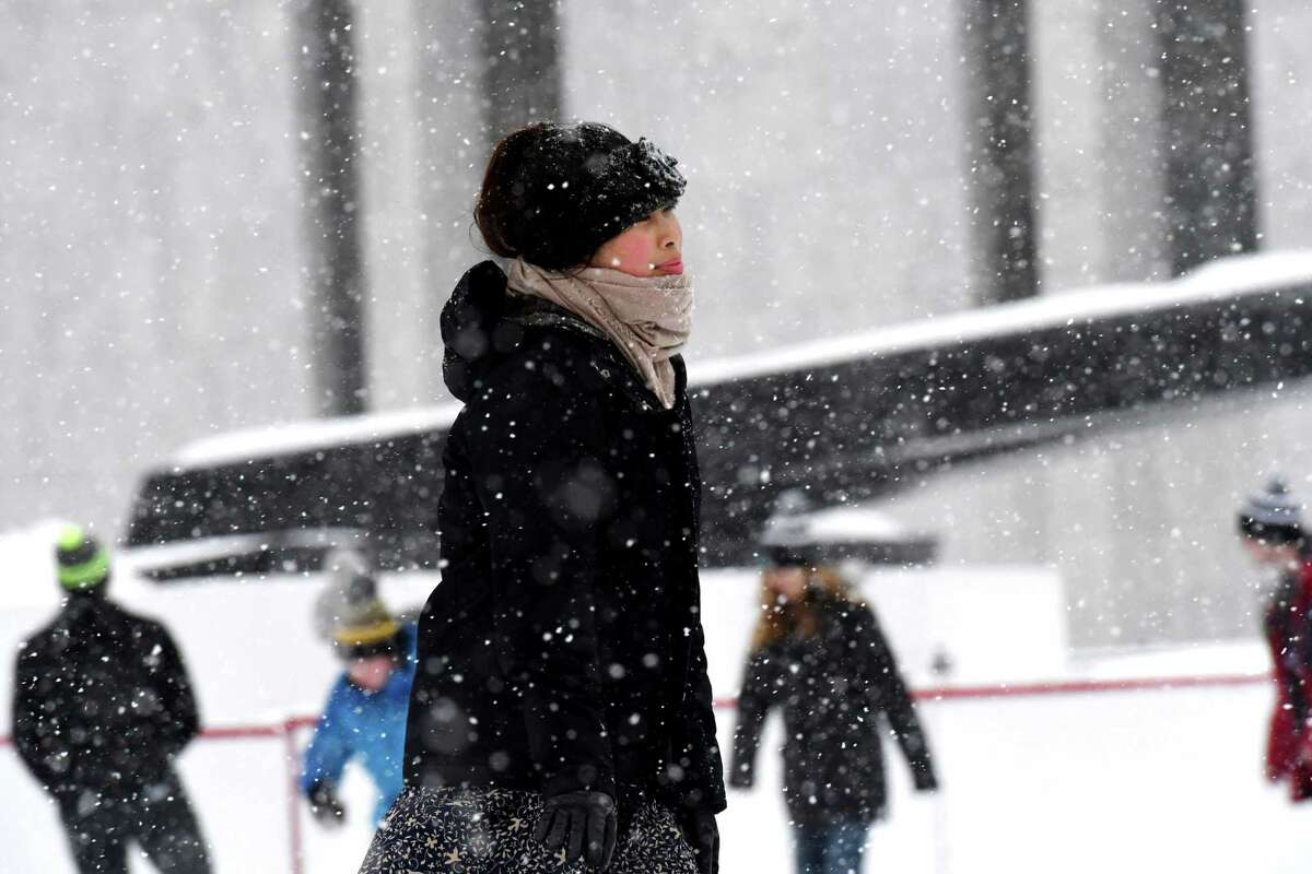Hannah Infantado of Latham ice skates through the snowflakes during opening day for the ice rink at Empire State Plaza on Friday, Dec. 6, 2019, in Albany, N.Y. (Will Waldron/Times Union)