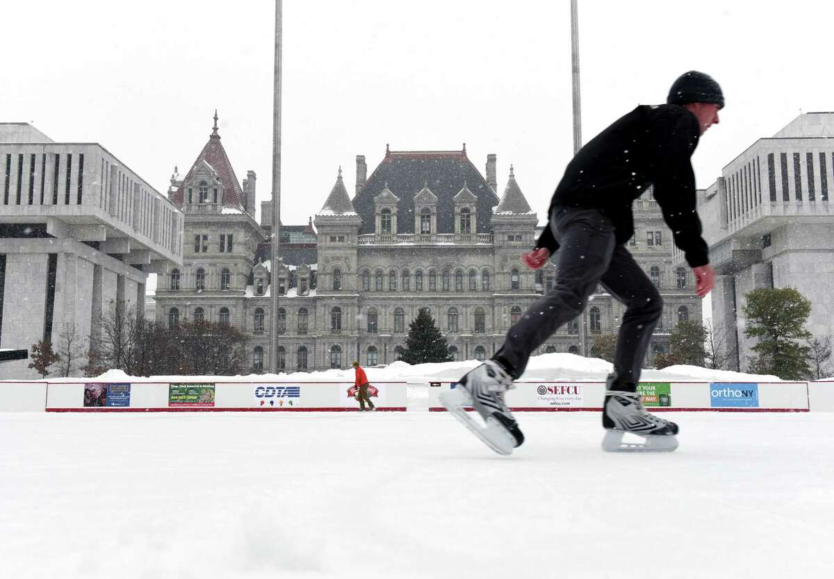 Skaters take to the ice during opening day for the ice rink at Empire State Plaza on Friday, Dec. 6, 2019, in Albany, N.Y. (Will Waldron/Times Union)