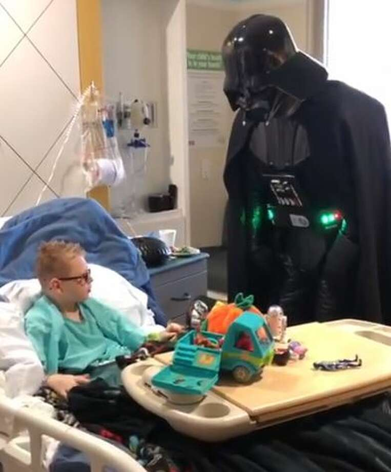 Ezra Menke of Tomball was recovering from his fourth brain surgery when he received the ultimate surprise from Darth Vader and some stormtroopers. Photo: Courtesy The Menke Family