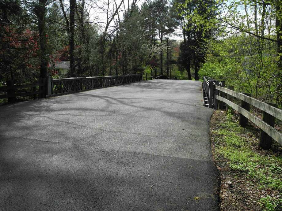 """The bridge at Arrowhead Road has been deemed in """"poor"""" condition by the state Department of Transportation. Photo: Jeannette Ross / Hearst Connecticut Media / Wilton Bulletin"""