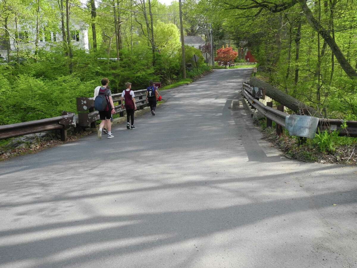Pedestrians walk from Merwin Meadows along the bridge on Lovers Lane. A public meeting on replacing the bridge will take place electronically on Oct. 15.