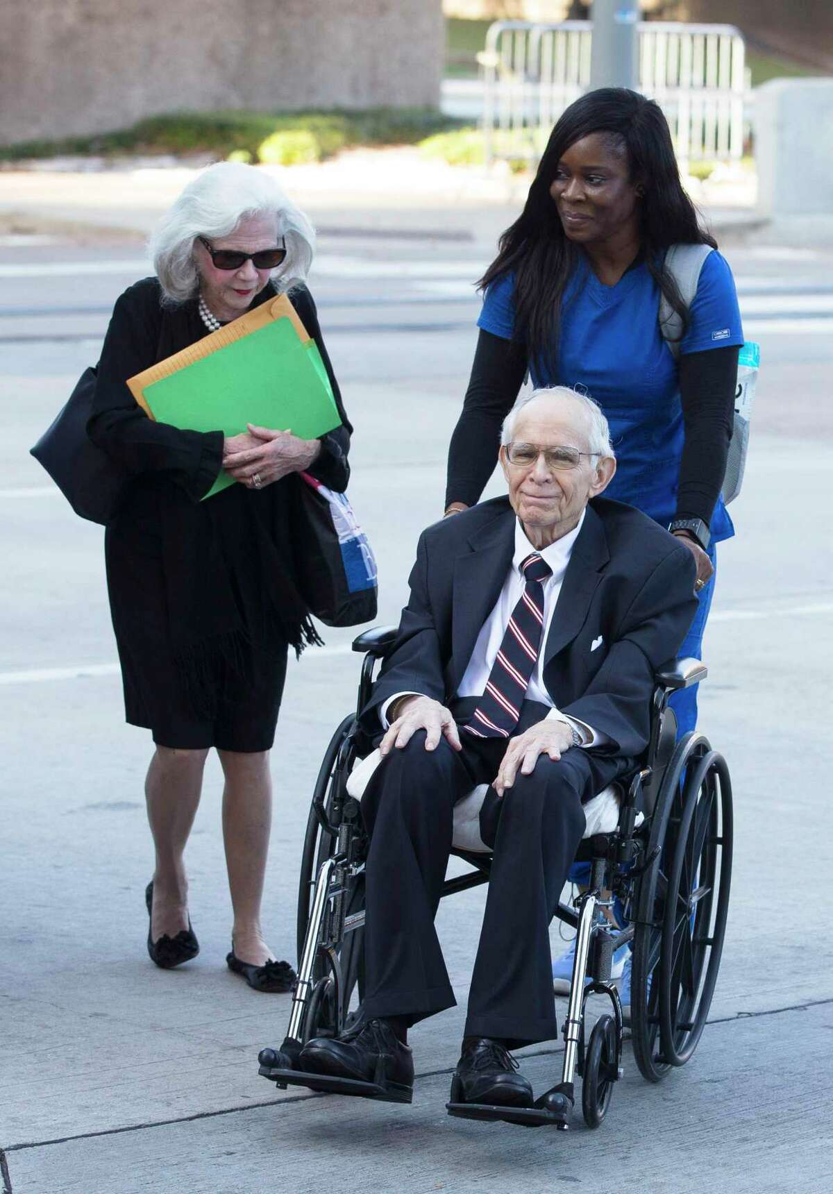 James Dannenbaum and wife Shirley Dannenbaum arrive to the Bob Casey United States Courthouse to appear in court on allegations of election fraud on Friday, Dec. 6, 2019, in Houston. Dannenbaum, a former University of Texas regent and ex-CEO of an influential engineering firm, pleaded guilty to campaign finance fraud.