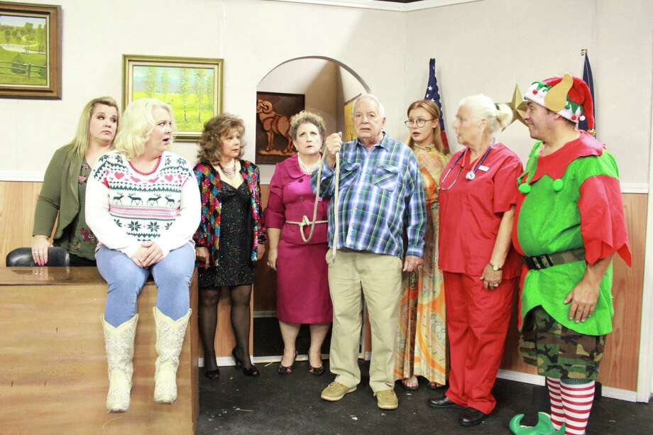 """Bruce Blifford, center,has to tie a rope around his sister, Patsy (Lisa Tolman), to make sure she attends a """"Battle of the Mangers"""" event in""""A Doublewide, Texas Christmas"""" Dec. 6-22 atPasadena Little Theatre.Other cast members are: Marla Miller, left, Cassie Wright, Judy Ahlhorn, Kayla Skinner, Julie Owen and Jeffrey Merriman. Photo: Pasadena Little Theatre / Pasadena Little Theatre"""