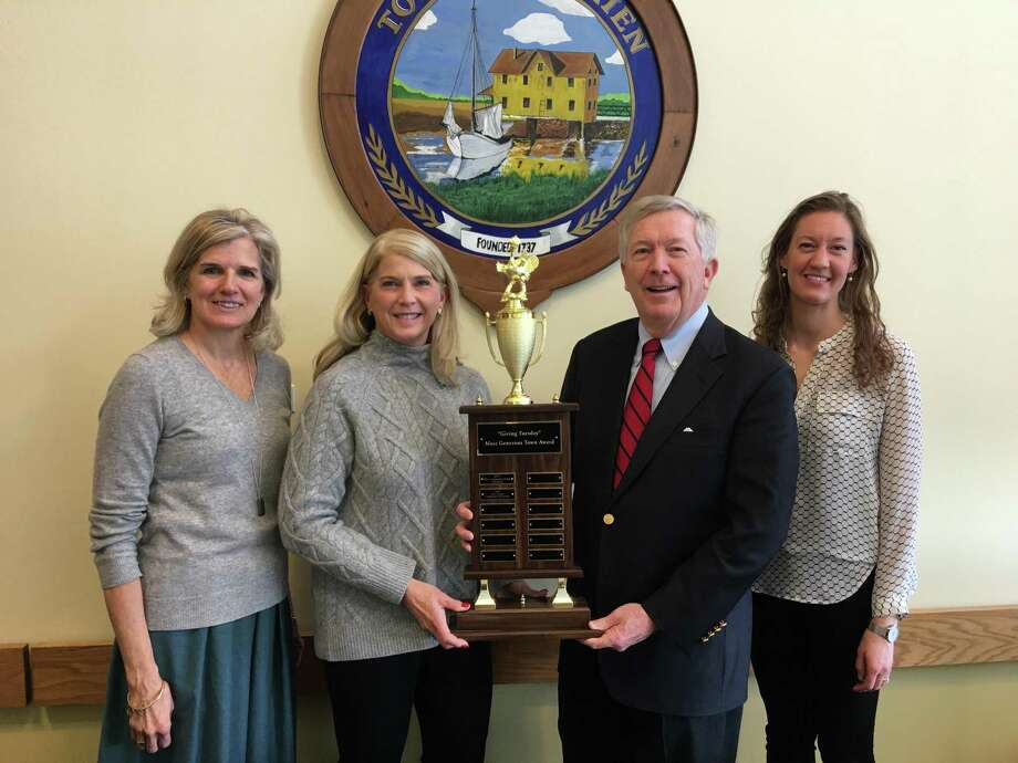 The transfer of the official Most Generous Town turkey trophy. Janet King, left, executive director, The Community Fund of Darien; Darien First Selectman Jayme Stevenson; New Canaan First Selectman Kevin Moynihan; and Lauren Patterson, President & CEO New Canaan Community Foundation. Photo: Contributed