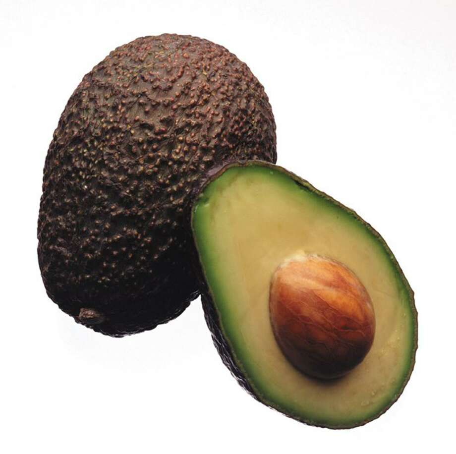 A longer-lasting avocado will soon fill Kroger produce bins nationwide as the chain doubles down on new technology that extends the shelf life of fruits and vegetables. The nation's largest grocer announced Wednesday that it has expanded its partnership with Apeel Sciences, a California startup that aims to reduce food waste by giving produce a spoilage-resistant skin. (JAMES F. QUINN/Chicago Tribune/TNS) Photo: JAMES F. QUINN, MBR / TNS / Chicago Tribune