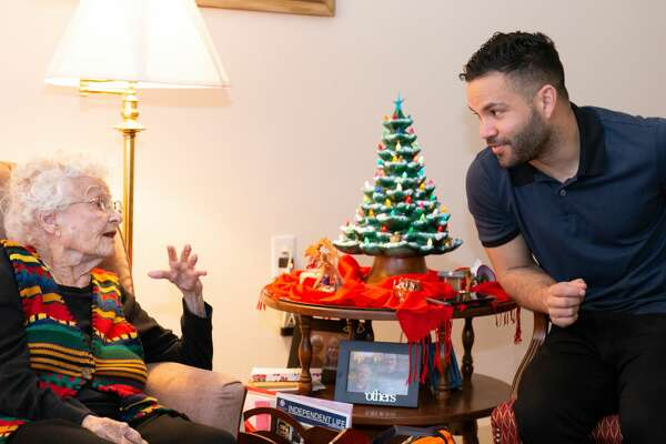 Houston Astros star Jose Altuve visited Shirley Clark on Friday at senior living community Buckner Parkway Place. Shirley Clark turned 100 on Dec. 2.
