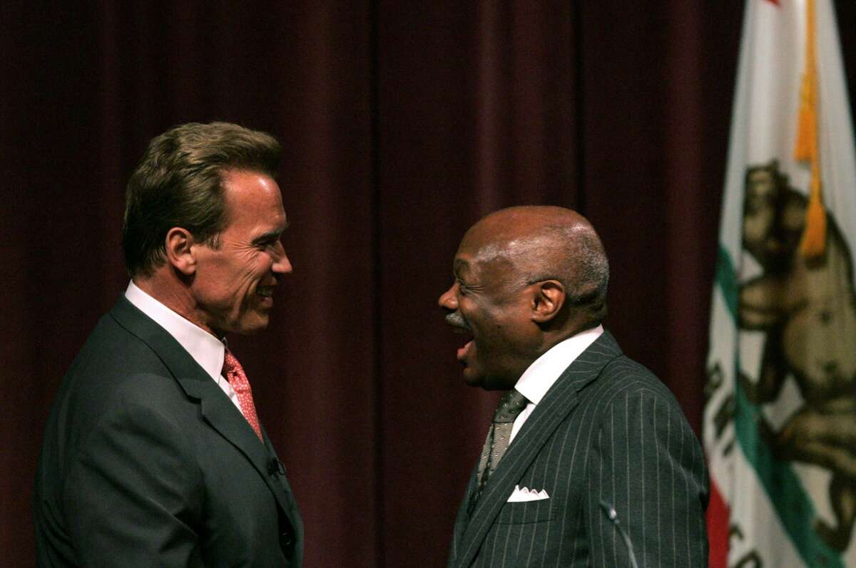 California governor Arnold Schwarzenegger (L) is greeted by former San Francisco mayor Willie Brown before delivering a speech to business and community leaders June 5, 2007 in San Francisco, California. Schwarzenegger addressed local leaders and business leaders outlining his vision for California's future.