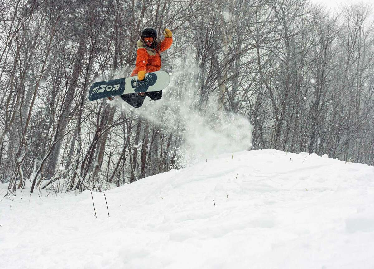 A snowboarder at Stratton Mountain Resort enjoys the fruits of a recent snowstorm on Monday, Dec. 2, 2019, in Stratton Mountain, VT. (Luke Robins/Stratton Mountain Resort)