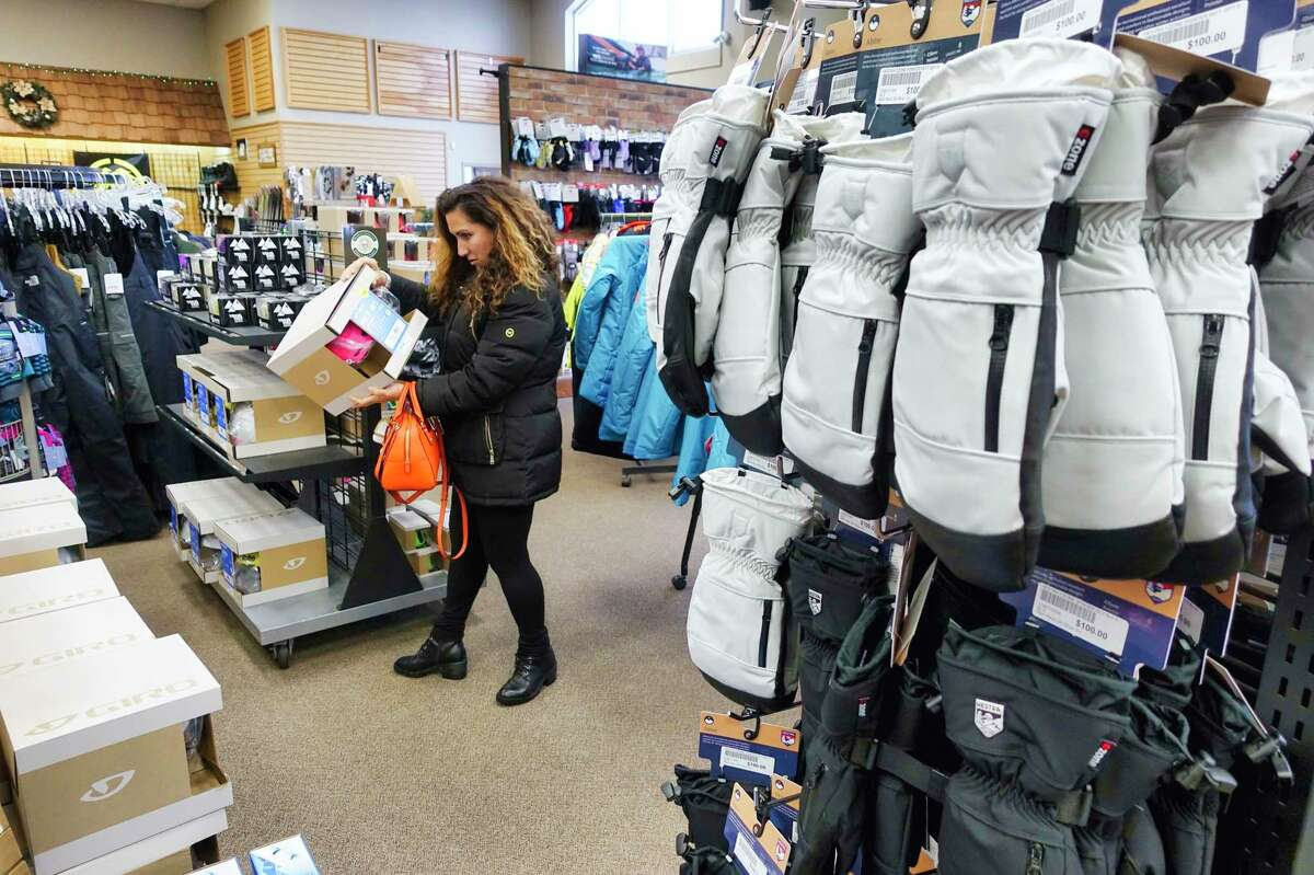 A shopper looks at a ski helmet as she shopped for ski gear for her daughter at Alpin Haus on Wednesday, Dec. 4, 2019, in Clifton Park, N.Y. Alpin Haus has expanded to New Jersey with the acquisition of Garick RV in Oak Ridge, N.J. (Paul Buckowski/Times Union)
