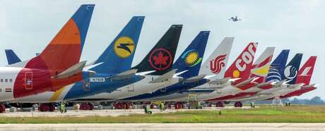 Grounded Boeing 737 Max 8 planes are seen Wednesday, Oct. 9, 2019 on the tarmac at Port San Antonio. They are among the new, undeliverable aircraft Boeing has manufactured since the FAA grounded the planes.