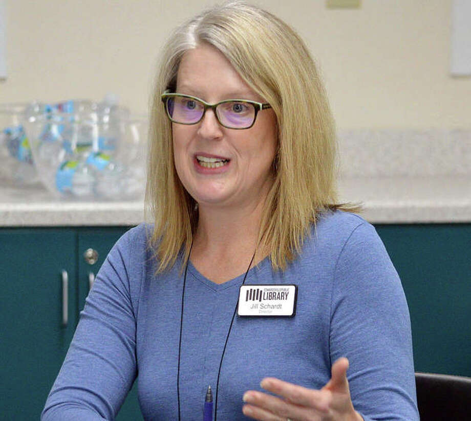 Edwardsville Public Library Director Jill Schardt speaks on Tuesday during the first meeting of the community resource group at the library.