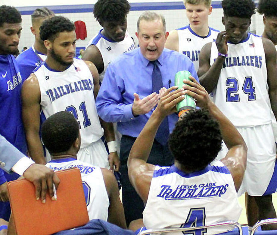 LCCC men's basketball coach Doug Stotler gives his team instructions during the team's home opener against Wabash Valley. Photo: Pete Hayes | The Telegraph