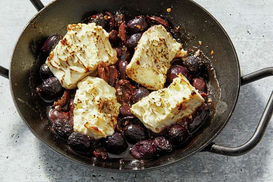 Roasted Feta With Grapes and Olives. Photo: Photo By Tom McCorkle For The Washington Post. / For The Washington Post