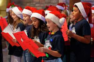 Students from Schneider Elementary School sing Christmas carrols during Montgomery County Precinct 3 Commissioner James Noack's annual Christmas with the Commissioner at The Woodlands Country Club-Palmer Course, Tuesday, Dec. 3, 2019, in Conroe. The toys given during the event will be distributed to children in need around Montgomery County.