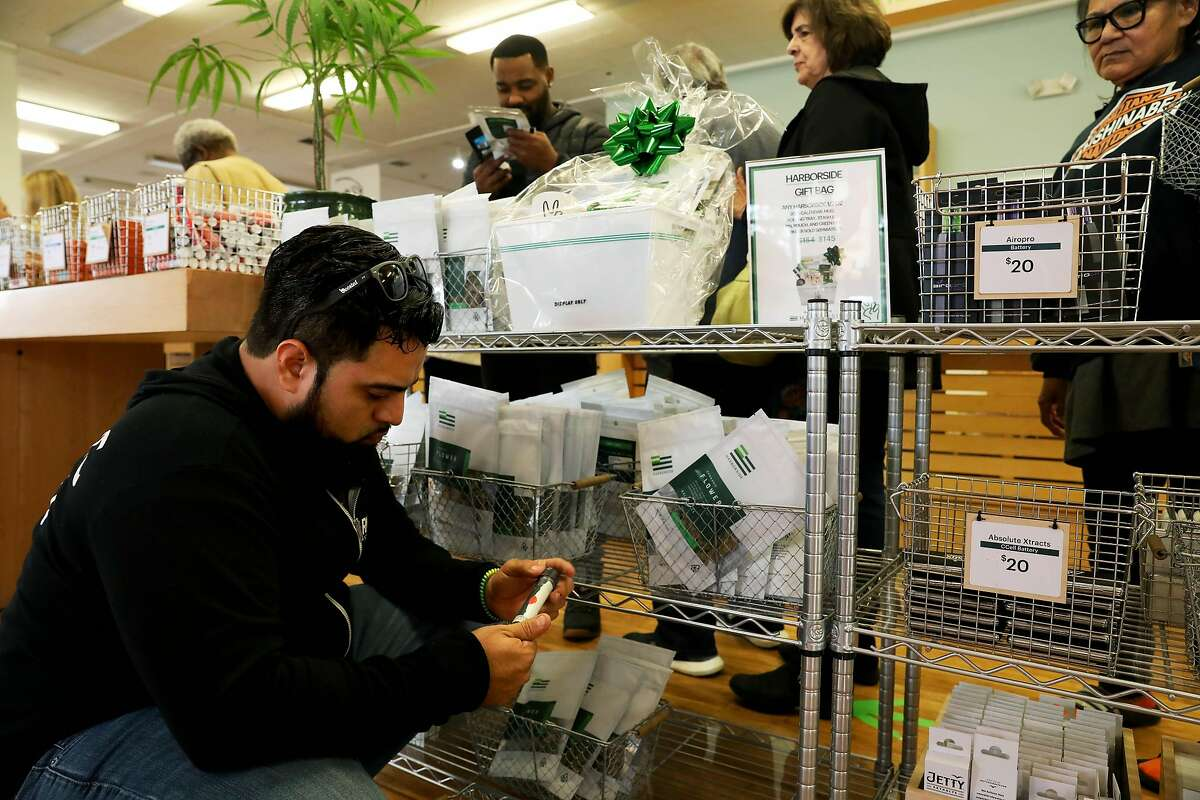 Hamill Cruz, of Miami, FL, looks at products during a visit to Harborside, located at 1840 Embarcadero, in Oakland, Calif., on Thursday, December 5, 2019. Harborside, one of the largest and oldest legal dispensaries in the U.S., is appealing a tax court's ruling for it to pay $11 million under 280E, a federal law that doesn't allow companies dealing in controlled substances to deduct many expenses.