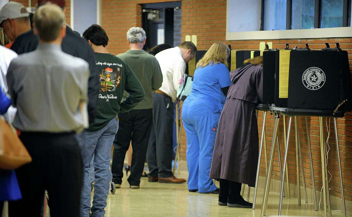 Voters line up at the polling site at Paschal High School in Fort Worth, Texas on Tuesday, Nov. 4, 2014. (Max Faulkner/Fort Worth Star-Telegram/TNS)