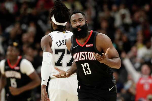 Houston Rockets guard James Harden (13) reacts after a score against the San Antonio Spurs during the second half of an NBA basketball game, in San Antonio, Tuesday, Dec. 3, 2019. San Antonio won 135-133 in double overtime. (AP Photo/Eric Gay)