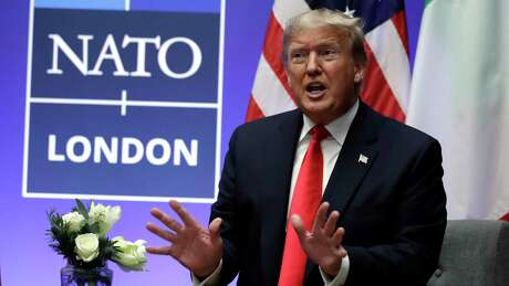 President Donald Trump speaks as he meets with Italian Prime Minister Giuseppe Conte during the NATO summit at The Grove, Wednesday, Dec. 4, 2019, in Watford, England.