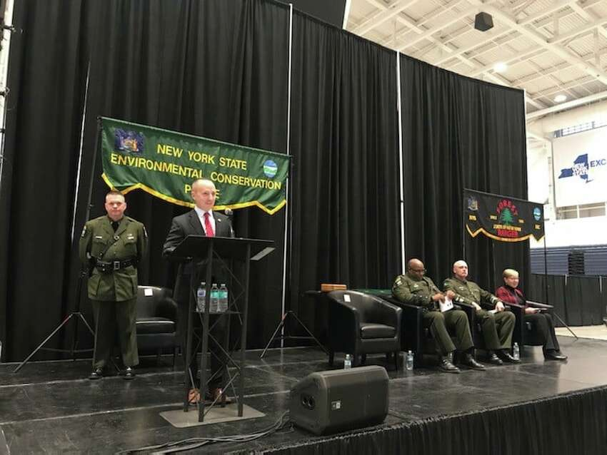 Thirty environmental conservation police officers and 14 forest rangers graduated from the state Department of Environmental Conservation's Basic School on Dec. 6, 2019, in Syracuese, N.Y. DEC Commissioner Basil Seggos addressed the new officers and rangers during the ceremony.