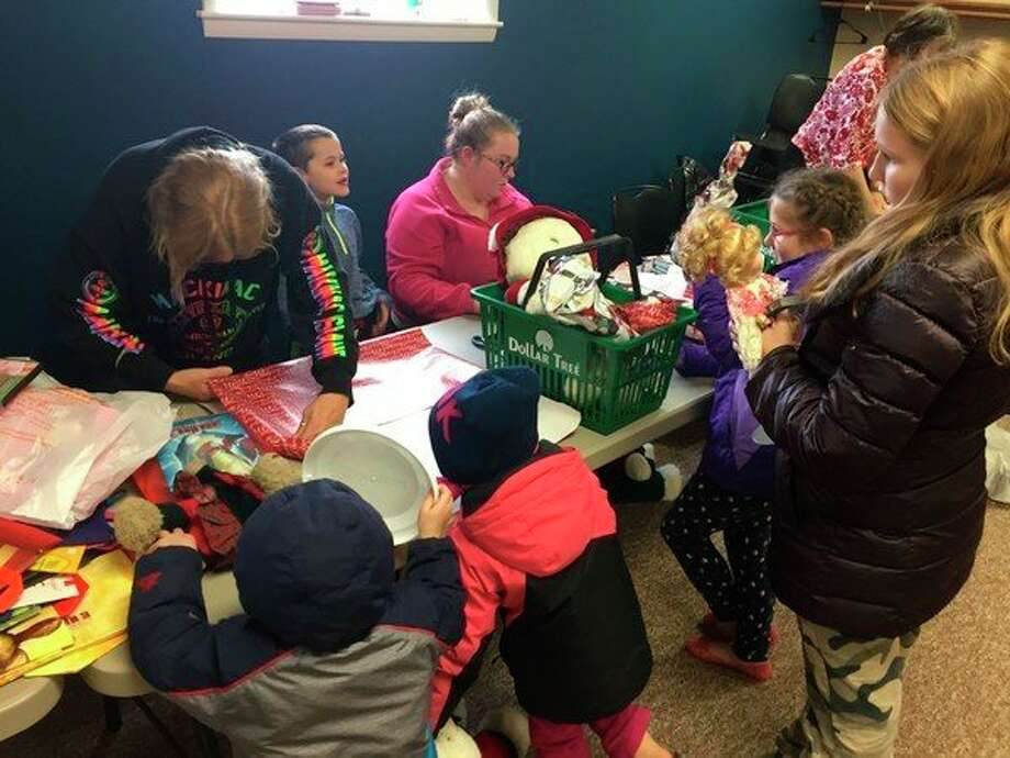 Local kids pick out presents at the Christmas Gift Giveaway in 2018. This year's edition will take place at the Bad Axe Knights of Columbus Hall. (Courtesy Photo)