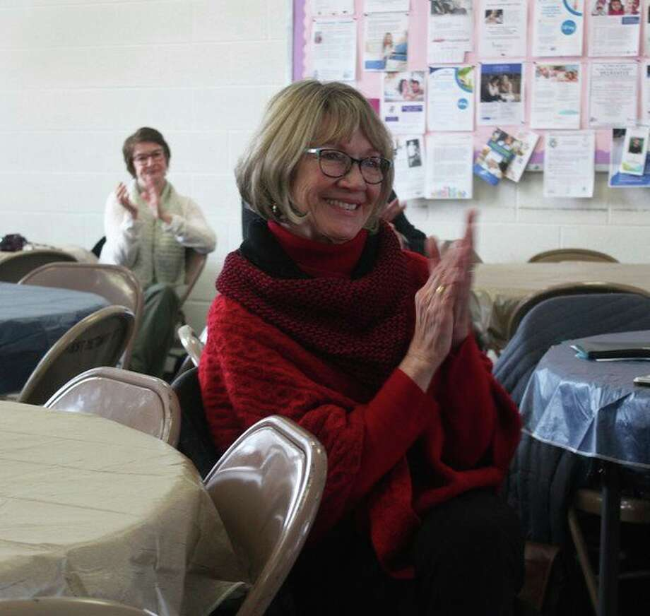 Jane Currie, WISE executive director, said she was pleased to see the support from area residents as they attended Giving Day Dec. 3. (Herald Review photo/Taylor Fussman)