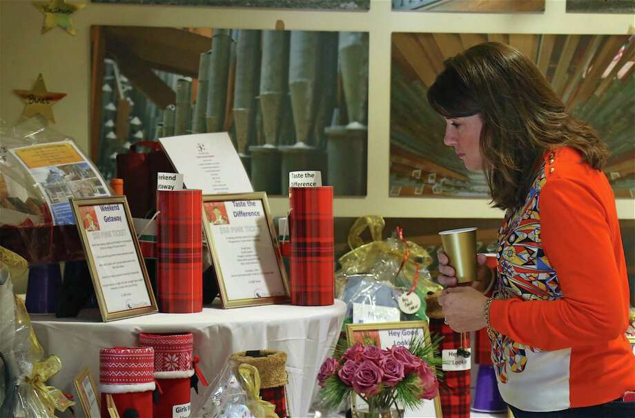 Charlotte Bartol of Fairfield looks over some items at the 4th annual Holiday Sip and Shop event at Christ & Holy Trinity Episcopal Church on Dec. 5, 2019, in Westport. Photo: Jarret Liotta / For Hearst Connecticut Media / Jarret Liotta / ©Jarret Liotta