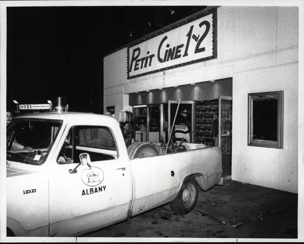 In 1983, a police truck holding confiscated projection equipment waits outside the