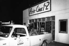 "In 1983, a police truck holding confiscated projection equipment waits outside the ""Petit Cine 1 and 2, a business then located at 810 Central Avenue in Albany. (Times Union archive)"