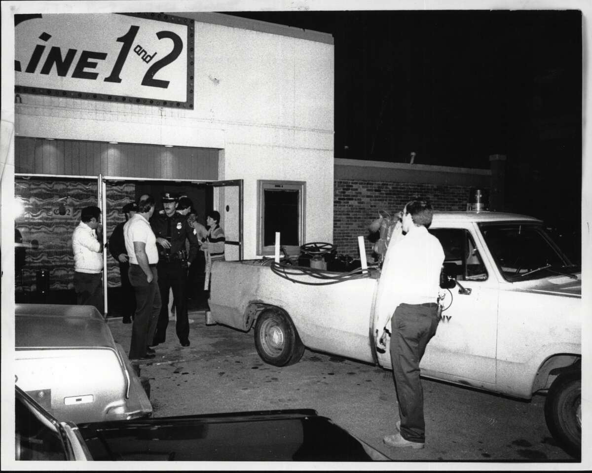 A police truck waits outside the Petit Cine 1 and 2 on Central Avenue in Albany in 1983. (Times Union Archive)