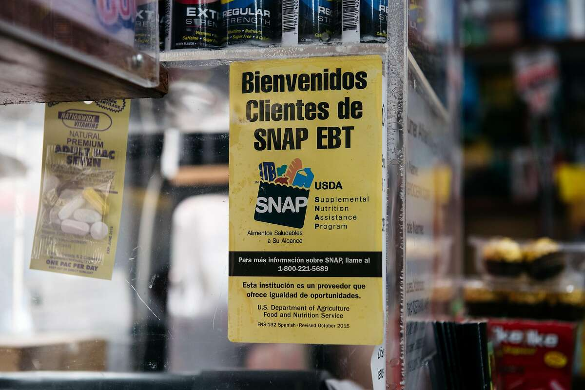 NEW YORK, NY - DECEMBER 05: A sign alerting customers about SNAP food stamps benefits is displayed in a Brooklyn grocery store on December 5, 2019 in New York City. Earlier this week the Trump Administration announced stricter requirements for food stamps benefits that would cut support for nearly 700,000 poor Americans. (Photo by Scott Heins/Getty Images)