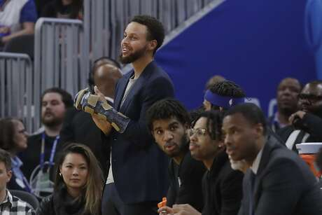 Golden State Warriors guard Stephen Curry, top, watches against the Chicago Bulls during an NBA basketball game in San Francisco, Wednesday, Nov. 27, 2019. (AP Photo/Jeff Chiu)