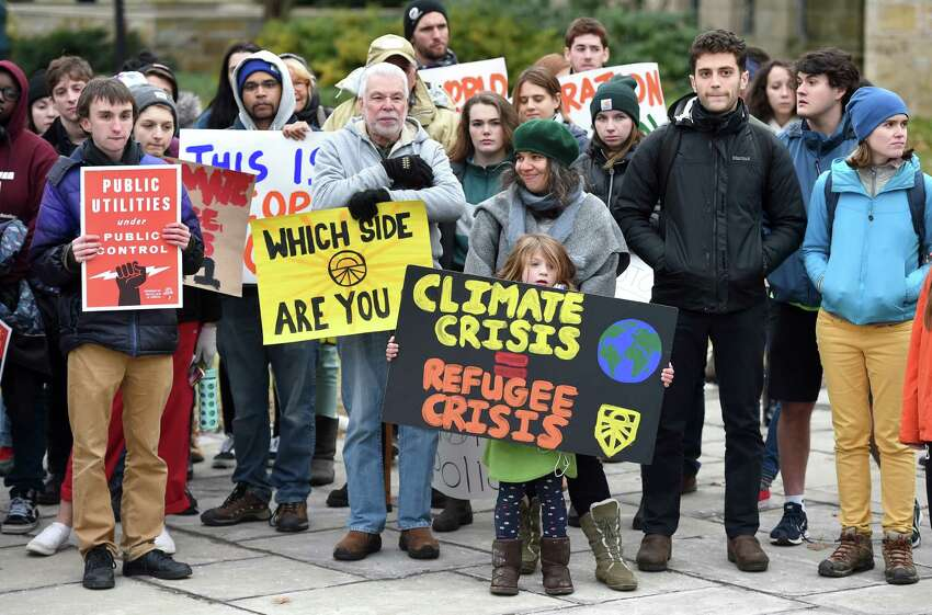 Participants in a climate strike make a stop at Yale University's Cross Campus in New Haven on December 6, 2019.