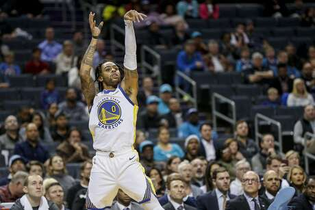 Golden State Warriors guard D'Angelo Russell (0) watches his shot against the Charlotte Hornets in the second half of an NBA basketball game in Charlotte, N.C., Wednesday, Dec. 4, 2019. Charlotte won 106-91. (AP Photo/Nell Redmond)