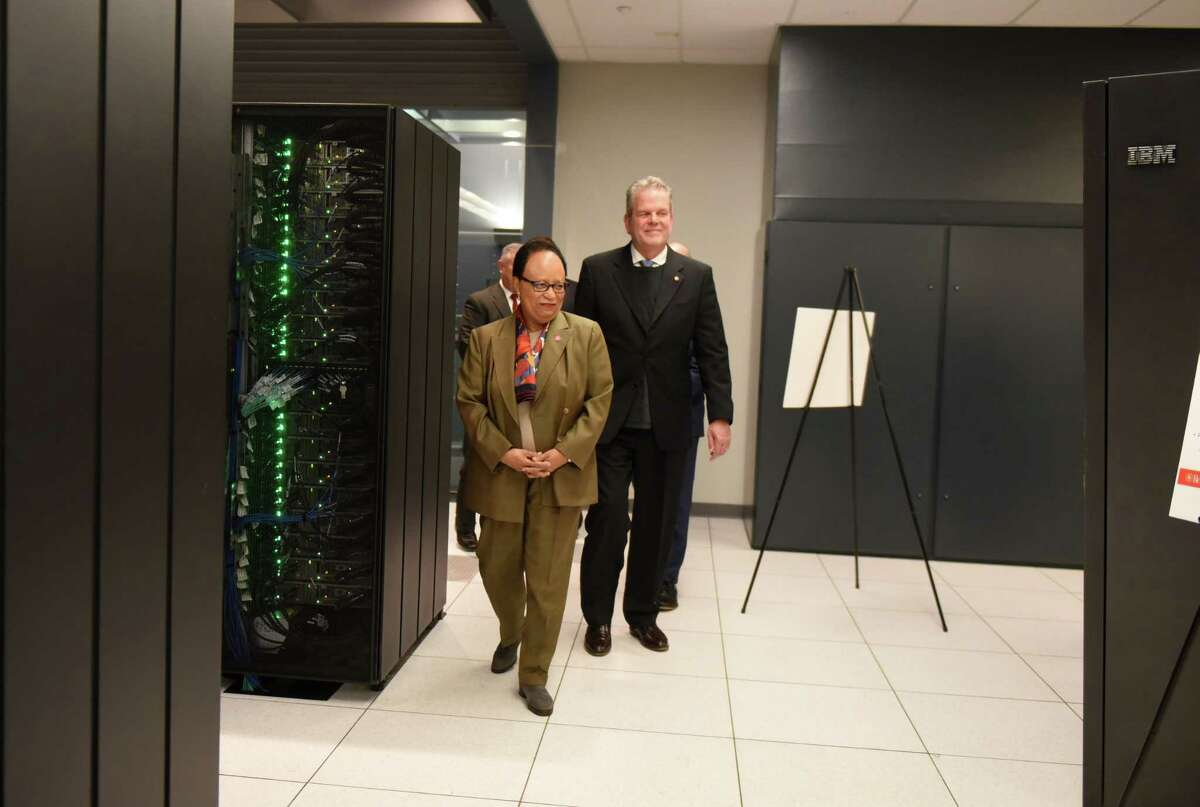 Rensselaer Polytechnic Institute President, Shirley Ann Jackson, left, and Curtis Priem, Nvidia co-founder, RPI 82, speaks during a ribbon cutting to open a new IBM AiMOS supercomputer at the Center for Computational Innovations on Friday, Dec. 6, 2019, in NorthGreenbush, N.Y. The Artificial Intelligence Multiprocessing Optimized System is powered by IBM POWER9 CPUs, manufactured at GlobalFoundries in Malta, as well as GPUS from NVIDIA. (Will Waldron/Times Union)