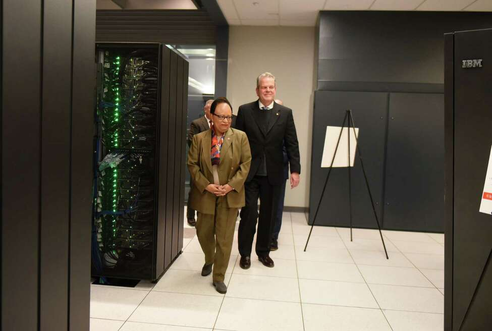 Rensselaer Polytechnic Institute President, Shirley Ann Jackson, left, and Curtis Priem, Nvidia co-founder, RPI 82, speaks during a ribbon cutting to open a new IBM AiMOS supercomputer at the Center for Computational Innovations on Friday, Dec. 6, 2019, in North Greenbush, N.Y. The Artificial Intelligence Multiprocessing Optimized System is powered by IBM POWER9 CPUs, manufactured at GlobalFoundries in Malta, as well as GPUS from NVIDIA. (Will Waldron/Times Union)