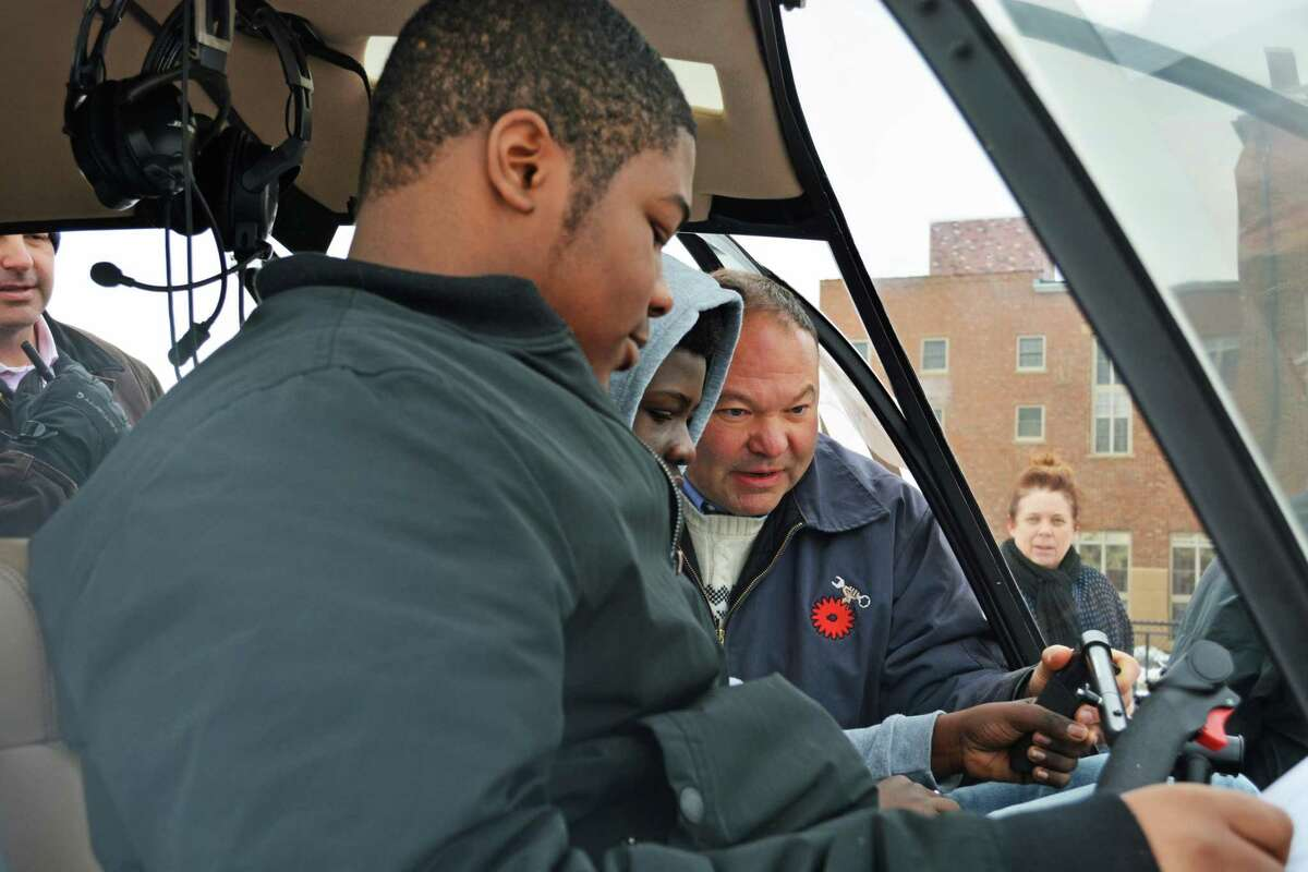 Paul Pelletier, Middletown High School aerospace and manufacturing instructor, far right, spoke with groups of 10 Woodrow Wilson Middle School students at a time Friday morning, answering questions and giving a select few a chance to sit inside the cockpit.