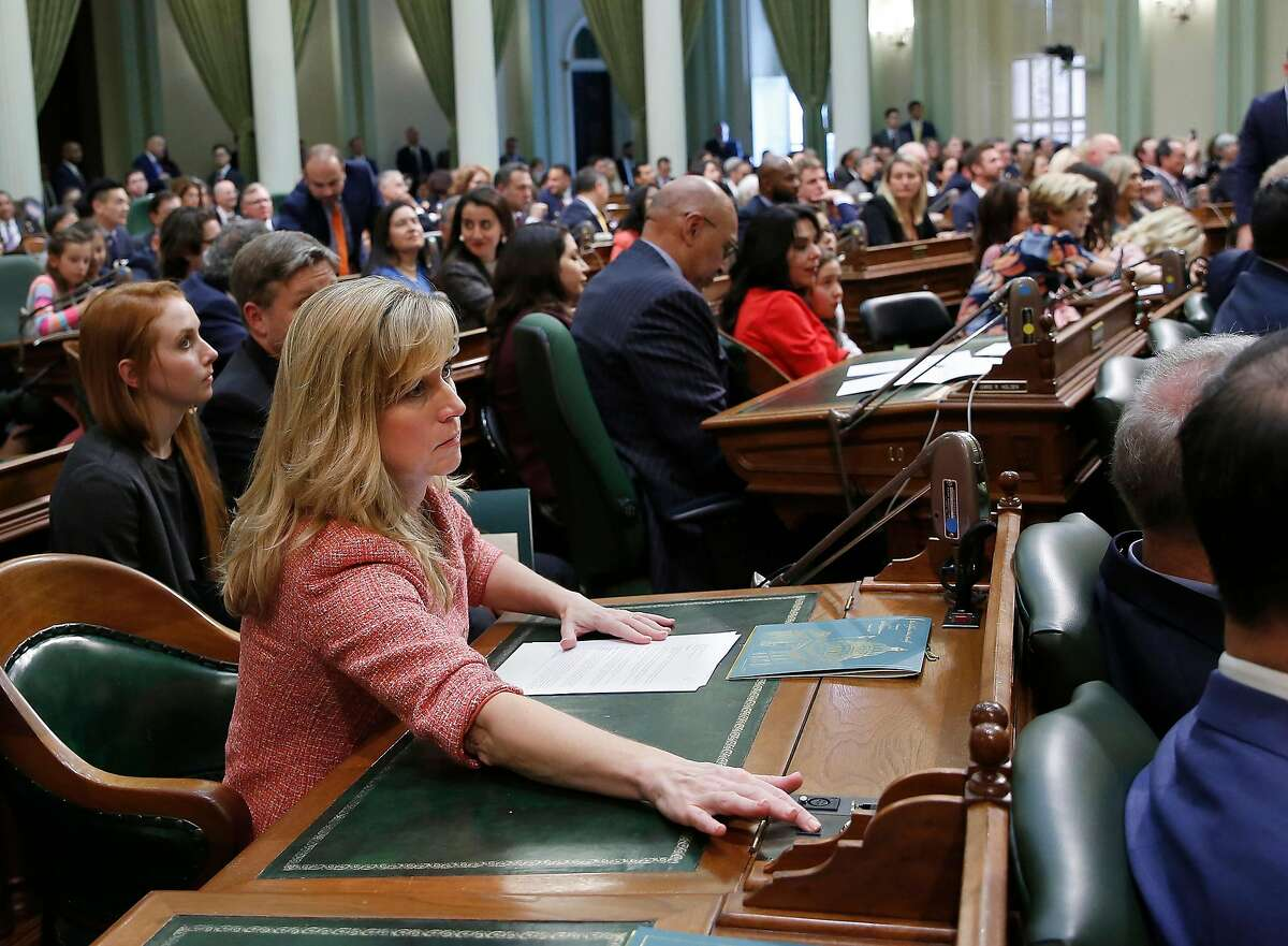 Freshman Assemblywoman Christy Smith, D-Santa Clarita, pushes the yes button on her desk as she cast one of her first votes as a member of the Legislature, Monday, Dec. 3, 2018, in Sacramento, Calif. Smtih, who defeated incumbent Republican Dante Acosta in November election, and the rest of the members of the Assembly took their oath of office to kick-off the new two-year legislative session. (AP Photo/Rich Pedroncelli)