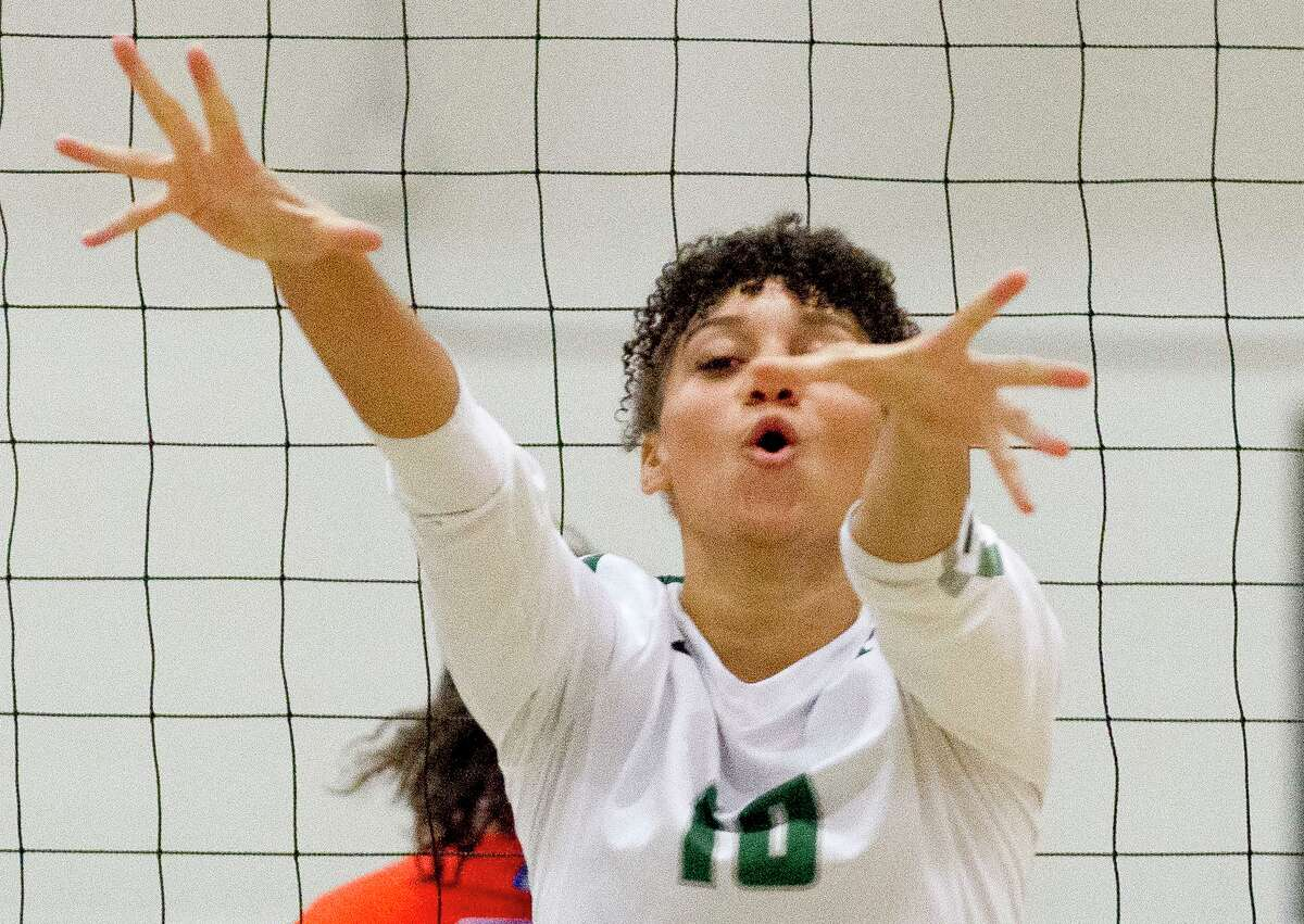 Kingwood Park middle hitter Erika Williams (10) reacts after blocking a shot during the first set of a District 20-5A high school volleyball match at Kingwood Park High School.