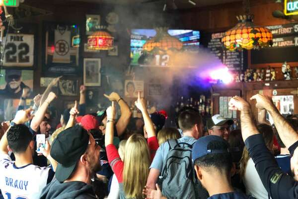 Patriots fans celebrate at the Connecticut Yankee bar in San Francisco.