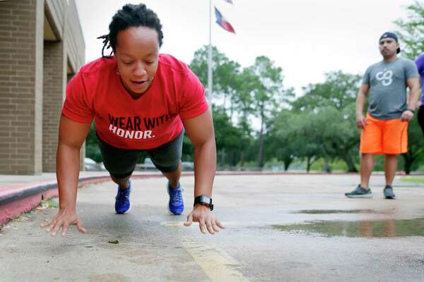 Melanie Jackson, left, demonstrates a push up technique as she leads one of her fitness classes outside of E.C. Mason Elementary School Wednesday, Oct. 16, 2019 in Manvel, TX.