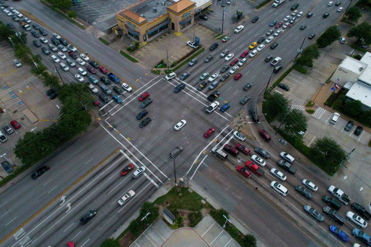 Westheimer Road spans ten lanes where it intersects with the eight lanes of Voss Road and Hillcroft Avenue, seen Sept. 20, 2018 in Houston.
