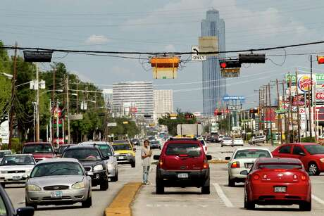 Traffic moves along on Westheimer Road near South Gessner on Aug. 20, 2013.