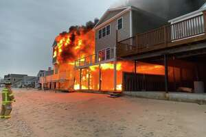 Firefighters are handling a multi-house fire on Beach Road West in Old Saybrook, Conn., on Dec. 6, 2019