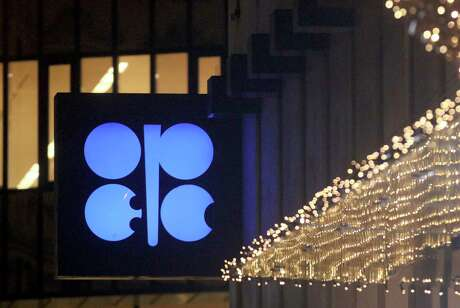 The advertising label of the Organization of the Petroleum Exporting Countries, OPEC, shines at their headquarters in Vienna, Austria, Thursday, Dec. 5, 2019. The countries that make up the OPEC oil-producing cartel are meeting Thursday to decide whether to cut production in order to support the price of fuel and energy around the world. (AP Photo/Ronald Zak)