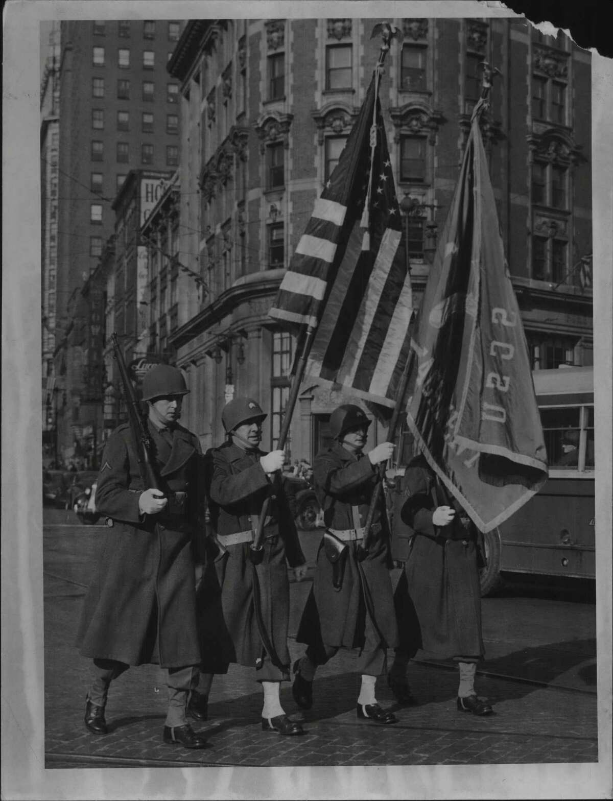 On Dec. 8, 1944, a Military Police color guard leads the way as Albanya€™s Pearl Harbor Day Parade starts out. It signaled the opening of an American Legion War Bond show in the Ten Eyck Hotel in Albany. The Japanese attack on the U.S. Naval Base in Hawaii was 78 years ago today. (Times Union Archive)