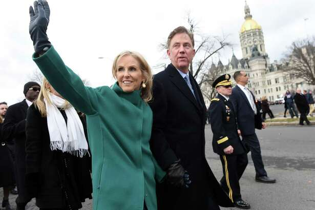 Governor Ned Lamont and his wife, Ann, walk in a parade outside of the Capitol Building in Hartford on Jan. 9 after his swearing in.