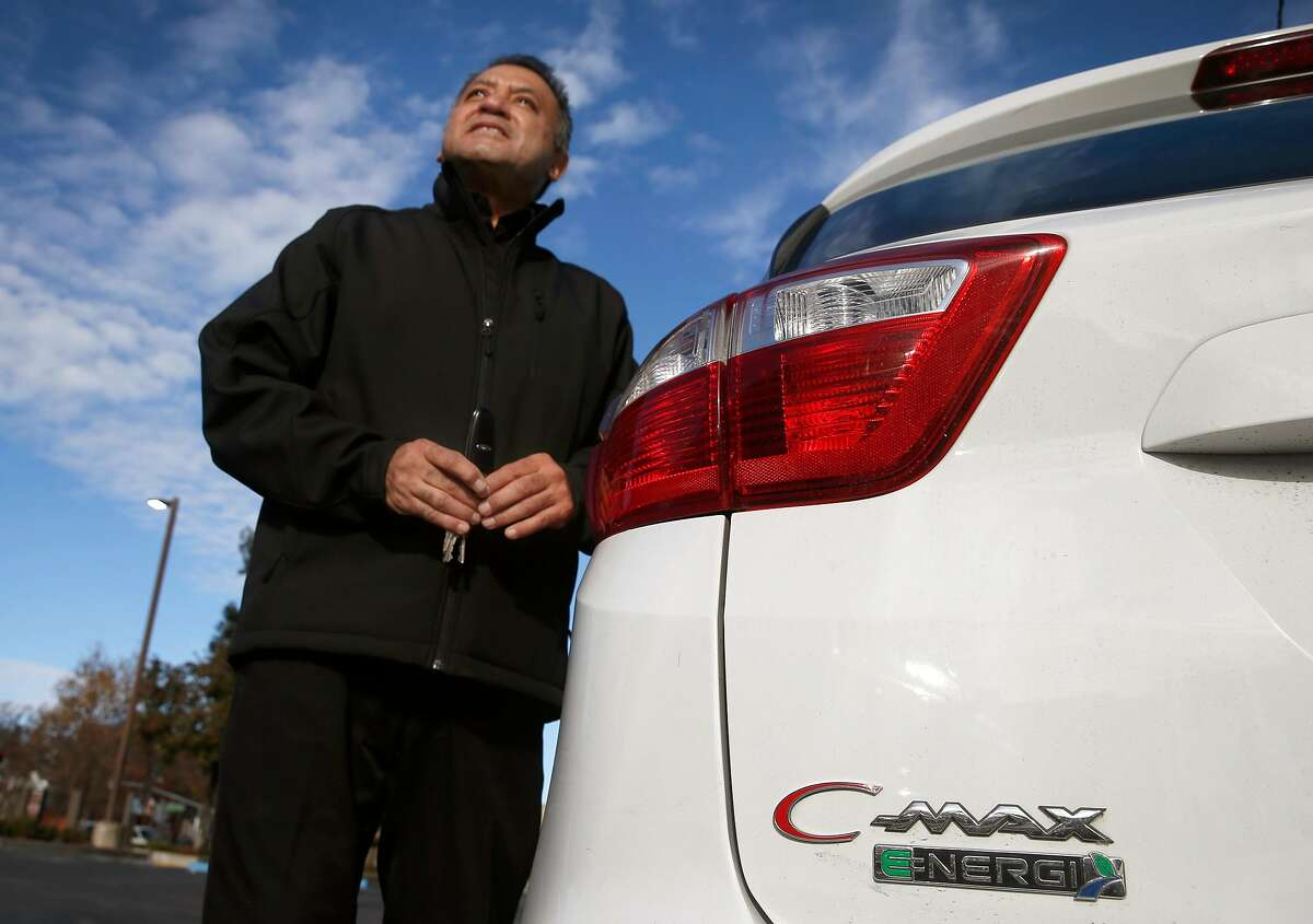 Ignacio Hernandez and his 2016 Ford C-Max hybrid sedan in Dublin, Calif. on Tuesday, Dec. 3, 2019. Hernandez received a $9,500 stipend from the Bay Area Air Quality Management District after junking his 1996 Toyota Camry with over 264,000 miles.