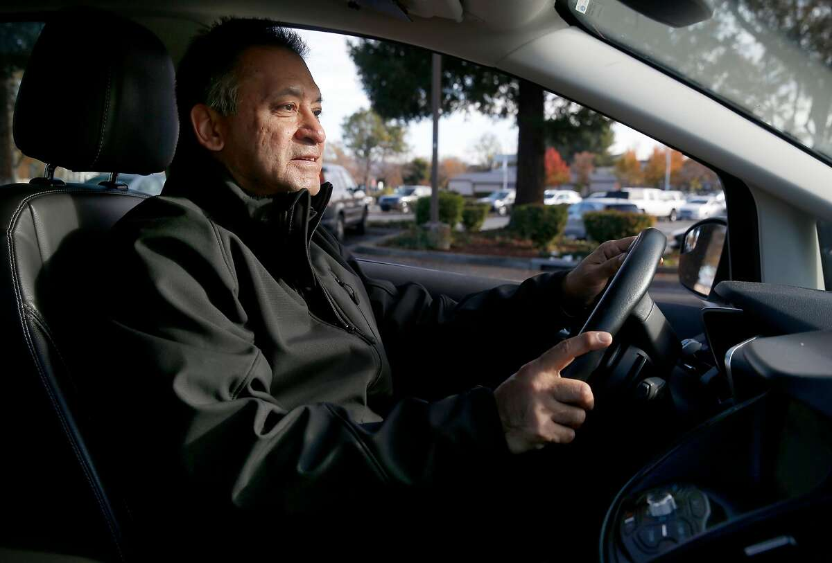 Ignacio Hernandez sits behind the wheel of his 2016 Ford C-Max hybrid sedan in Dublin, Calif. on Tuesday, Dec. 3, 2019. Hernandez received a $9,500 stipend from the Bay Area Air Quality Management District after junking his 1996 Toyota Camry with over 264,000 miles.